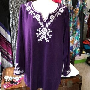 Woman with in velour purple tunic top